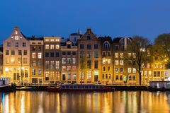 Canals and tradition house in Amsterdam at night. Amsterdam is t Stock Image