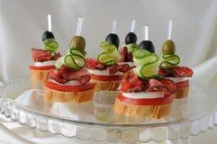 Canapés with salami Royalty Free Stock Photography