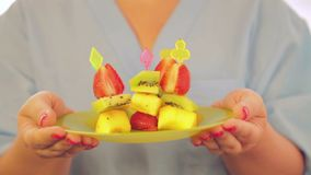 Canapé of fresh peach strawberry and kiwi fruits. stock video