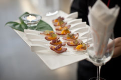 Canapés. On butler's hand being served Stock Photography