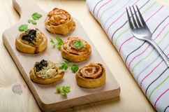 Canap�s puff pastry. With spinach, garlic blue cheese, easy snack Royalty Free Stock Photo