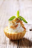 Canape. Tart shell with savory spread filling topped with roasted almonds royalty free stock photo