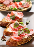 Canape. With cream cheese, salami and herbs royalty free stock images