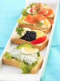 Canape. Mix with caviar, shrimp and with salmon royalty free stock images