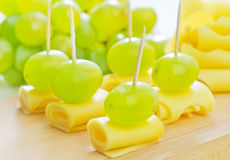 Canape. With grape and cheese royalty free stock photo