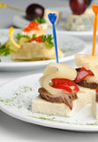 Canape with baked meat, pineapple and pepper. Canape with baked meat and slice of pineapple and red pepper, served on plate Royalty Free Stock Photography