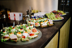 Canape on the bar table. Canape with ham, tomato and cucumber on the bar Royalty Free Stock Photos