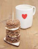 Canape biscuit with banana and walnut - chocolate cream. Cup of Stock Images