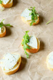 Canape with blue cheese and fresh rocket Royalty Free Stock Images