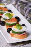 Canape with boiled egg, cucumber vertical Stock Photos