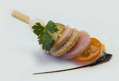 Canape. Bread cucumber tomato meat Royalty Free Stock Photos