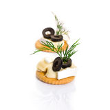 Canape with Brie Cheese and Olives Stock Photos