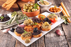 Canape, buffet food. On wood royalty free stock photo
