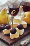 Canape with camembert cheese and grape Stock Photography