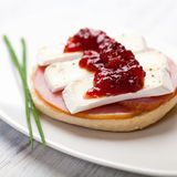 Canape with camembert and cranberry jam Stock Photography