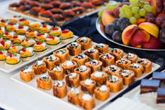 Plates full of snacks Stock Images
