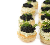Canape with caviar. On a white background stock photo