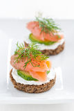 Canape with cheese, cucumber and salmon, vertical Royalty Free Stock Photography