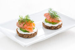 Canape with cheese, cucumber and salted salmon Stock Image