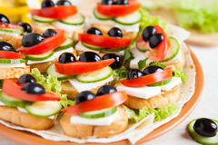 Canape with cheese feta and vegetables Royalty Free Stock Photo