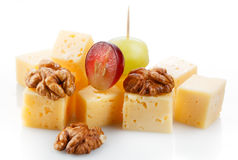 Canape with cheese, grape, olive and nuts. Macro. Canape with cheese, grape, olive and nuts isolated on white background. Macro Stock Photos