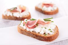 Canape with cheese and prosciutto Royalty Free Stock Photos
