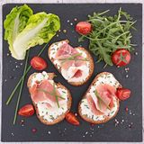 Canape with cheese and prosciutto Stock Images