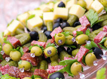 Canape with cheese, salami,olive Stock Image