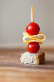 Canape with cherry tomato, cheese and whole grain bread Royalty Free Stock Image