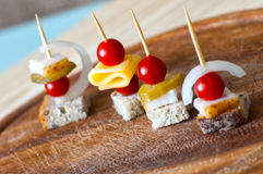 Canape with cherry tomato, cheese and whole grain bread Royalty Free Stock Images