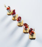 Canape with cherry-tomato and soft cheese Royalty Free Stock Images