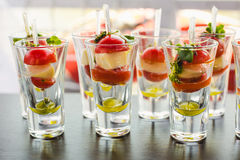 Canape with cherry tomatoes, cheese, olives on skewers Royalty Free Stock Image