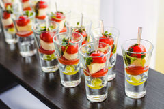 Canape with cherry tomatoes, cheese, olives on skewers Royalty Free Stock Images