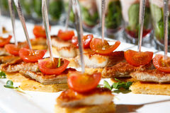 Canape cherry tomatoes meat plate catering. Canape red cherry tomatoes meat small plate catering Stock Image