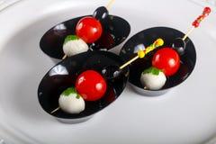 Canape com tomate e mozarella Fotografia de Stock