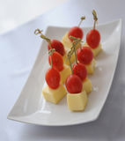 Canape con i pomodori ed il formaggio Fotografia Stock