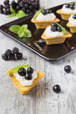 Canape with cottage cheese and  black berries of mountain ash Stock Photo
