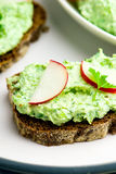 Canape with cottage cheese, greens and a garden radish. Royalty Free Stock Image