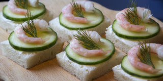 Canape with cream cheese, cucumber and shrimp Stock Photo