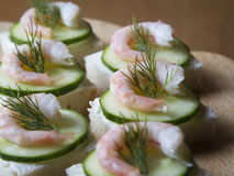 Canape with cream cheese, cucumber and shrimp Stock Image