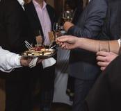 Canape dish held by waiter Royalty Free Stock Photos