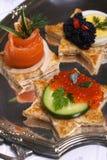 Canape dos salmões e do caviar Fotografia de Stock Royalty Free