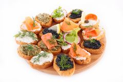 Canape, finger food. On board on white royalty free stock photography