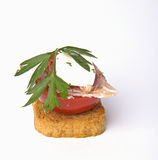 Canape of fresh cheese, tomato and ham Stock Photo