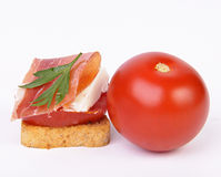 Canape of fresh cheese, tomato and ham Stock Images