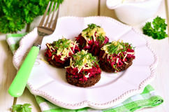 Canape from fried rye bread with beetroot,carron,garlic and chee Stock Photo