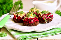 Canape from fried rye bread with beetroot,carrot,garlic and chee Royalty Free Stock Photography