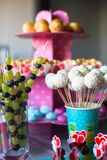 Canape of fruit, white chocolate cake pops and Stock Images