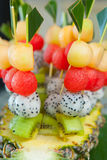 Canape with fruits on the wedding party Stock Images