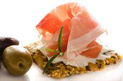 Canape of full corn crisps with  prosciutto Royalty Free Stock Image